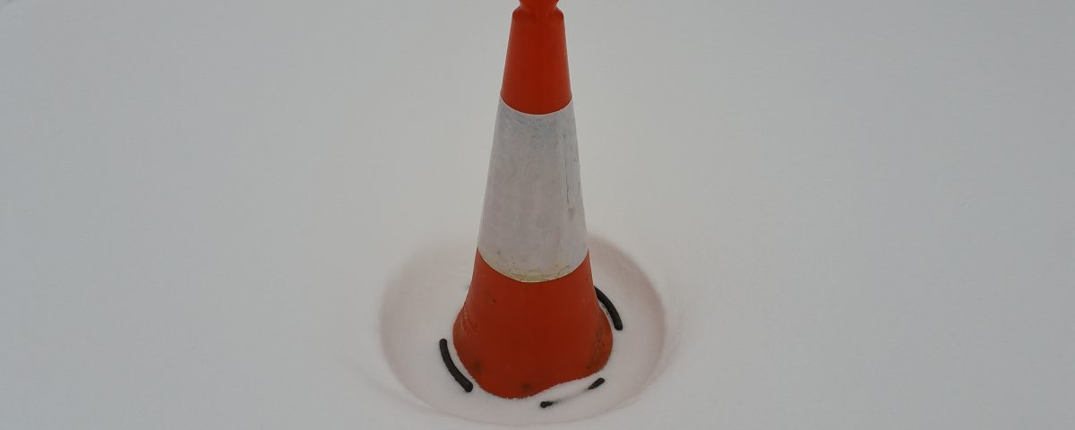 Traffic cone in snow.